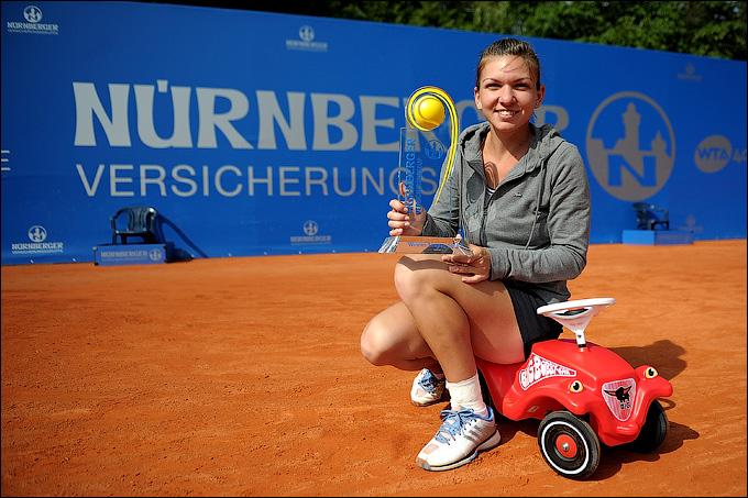 Симона Халеп с первым турнирным трофеем