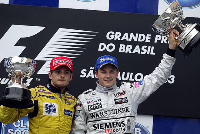 Физикелла и Райкконен на подиуме Гран-при Бразилии