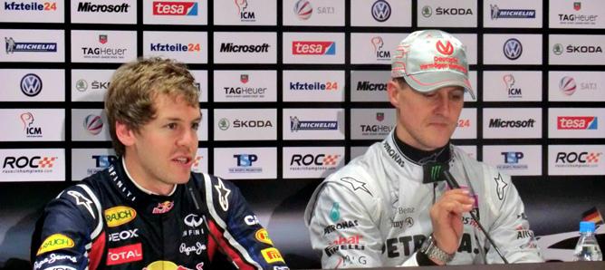Себастьян Феттель и Михаэль Шумахер на пресс-конференции
