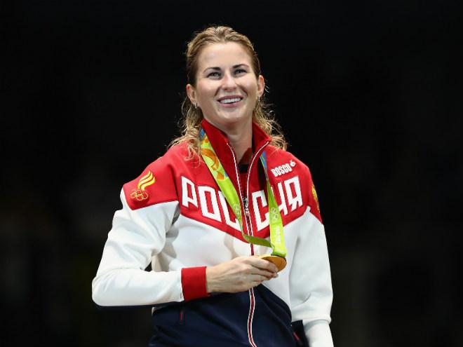 Инна Дериглазова на олимпийском пьедестале