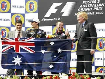 Марк Уэббер на подиуме Гран-при Австралии 2002 года
