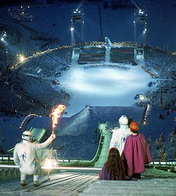 Стейн Груббен готовится совершить свой знаменитый прыжок с олимпийским факелом