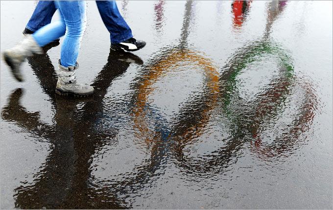Олимпиада идёт под аккомпанемент дождя