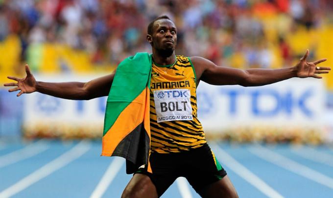 Усэйн Болт с флагом Ямайки