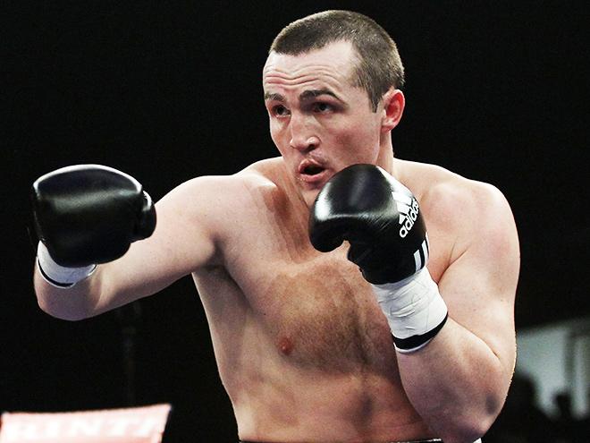 Денис Лебедев сохранил чемпионский титул