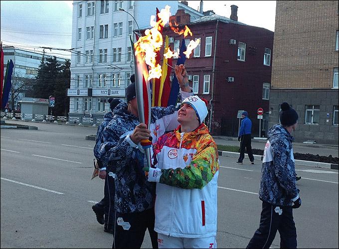 Через несколько секунд моя частичка олимпийского огня погаснет