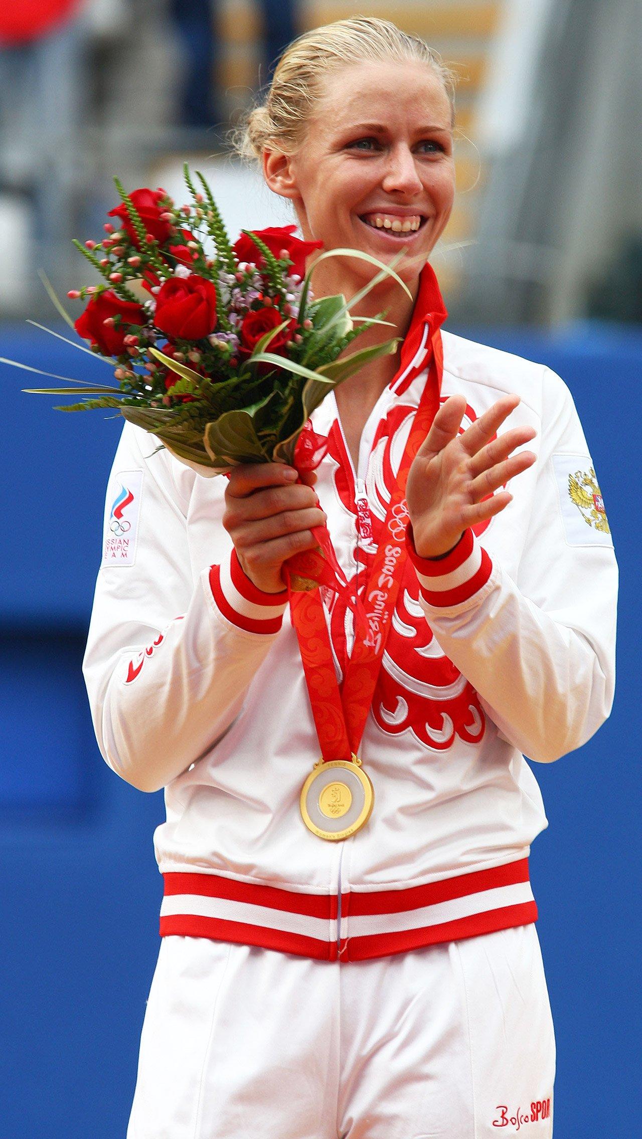 А Елена Дементьева завоевала золото Олимпиады в Пекине-2008.