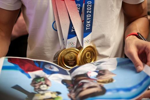 Сколько стоит золото. В каких странах олимпийские чемпионы получают наибольшие призовые